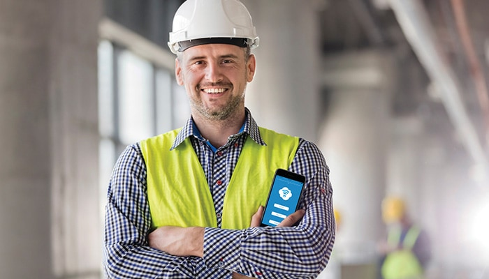 Man holding phone with Clarity app for Acuity Brands